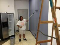 CEO Faith Geronimo lends a hand with the painting, adding some color to our office.